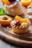 Sweet tarts with cherry and apricot Stock Image