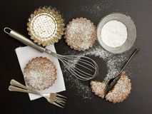 Sweet tarts and tools. Sweet tarts with sugar and kitchen tools stock photography
