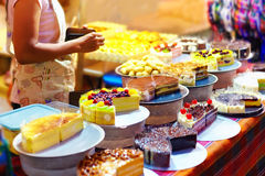 Sweet tasty cakes  on display at pastry stall, at night street market Royalty Free Stock Photography