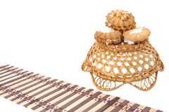 Sweet tasty cookies. With a basket and mat on a white background Royalty Free Stock Images