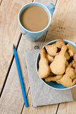 Sweet tasty cookies in the blue plate, a cup of coffee with milk Stock Images