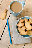 Sweet tasty cookies in the blue plate, a cup of coffee with milk Royalty Free Stock Photo