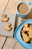 Sweet tasty cookies in the blue plate, a cup of coffee with milk Royalty Free Stock Image