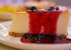 Sweet and tasty - fresh cheescake with red berry jam Stock Images
