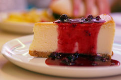 Sweet and tasty - fresh cheescake with red berry jam. Spain Stock Image