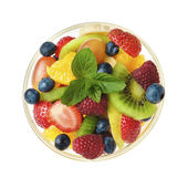Sweet tasty fruit salad. In the bowl isolated Royalty Free Stock Photos