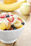 Sweet tasty fruit salad in the bowl with whipped cream Stock Photography