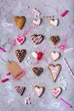Sweet tasty heart shaped cookies with love label on grey cracked surface. Top view of sweet tasty heart shaped cookies with love label on grey cracked surface Royalty Free Stock Image