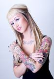 Sweet Tattoo Girl. Blond girl with a lot of wild tattoos royalty free stock photo