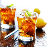 Sweet tea with lemon slices and mint Royalty Free Stock Images