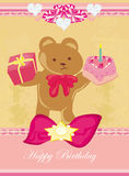 Sweet teddy bear holding a birthday cake Royalty Free Stock Photo