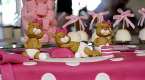 Sweet teddy bears on a  pink birthday cake Royalty Free Stock Photos