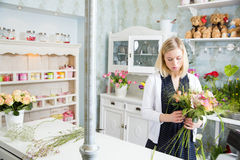 Sweet and tender indoors with the beautiful florist Royalty Free Stock Image