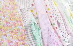 Sweet textile colours on display. Rolls of sweet textile patterns on display in the store Royalty Free Stock Images