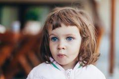Sweet thoughtful little girl Stock Photo