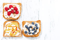 Sweet toast with different toppings on white wooden table Stock Images