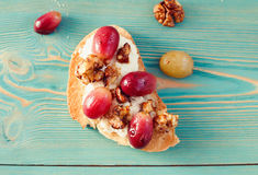 Sweet toast with red grape, ricotta, walnut on blue table. Sweet toast with red grape, ricotta, walnut on blue wooden table Stock Image
