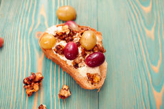 Sweet toast with red and white baked grape, tasty breakfast. Sweet toast with red and white grape, tasty breakfast on blue wooden table Royalty Free Stock Photography