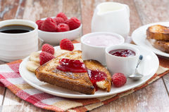Sweet toasts with fresh raspberry, jam and yoghurt Stock Photography