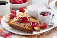 sweet toasts with fresh raspberry, jam and yoghurt, close-up Royalty Free Stock Photo