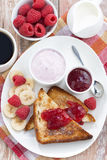 sweet toasts with fresh raspberry, jam and yoghurt, top view Royalty Free Stock Image