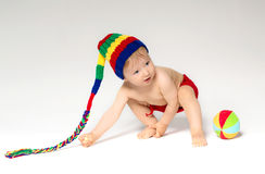 Sweet toddler with a ball Stock Images