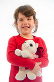 Sweet toddler girl play with pussy cat plush isolated on white Stock Images