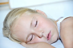Sweet toddler little girl sleeping. In bed Royalty Free Stock Photography