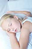 Sweet toddler little girl sleeping. In bed Stock Photos