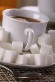 Sweet tooth. Tea or coffee drink with lots of sugar cubes Royalty Free Stock Images