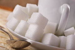 Sweet tooth. Tea or coffee drink with lots of sugar cubes Royalty Free Stock Photos