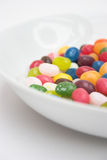 Sweet tooth!. The edge of a bowl of sweets - selective focus Stock Images