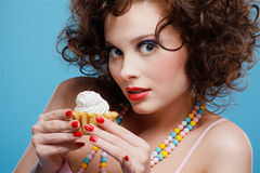 Sweet tooth. Portrait of beautiful curly brunette girl with tart Stock Photography