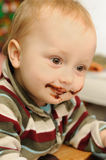 Sweet-tooth. Portrait of little child with dirty chocolate mouth Stock Photo