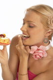 Sweet tooth woman Royalty Free Stock Photo