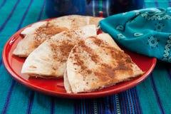 Sweet tortilla dessert with cinnamon. Sweet tortillas with cinnamon for dessert in a colorful setting Stock Image