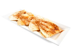Sweet tortilla dessert with cinnamon. Sweet tortillas with cinnamon for dessert on white background Stock Photo