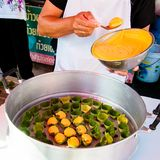 Sweet traditional Thai dessert, wrapping and serving on banana leaves Stock Photos