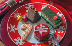 Sweet tray for Christmas. Delicious sweet tray for Christmas party. dobos torte, slice of mint and chocolate cake, cappachino chocolate cake, and sugar cookies Stock Images