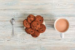 Sweet treat. cookies on plate and cup of cocoa on table top view close-up stock image