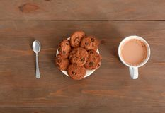 Sweet treat. cookies on plate and cup of coffee on table top view close-up stock photography