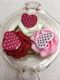 Three Valentine Cupcakes. This is a sweet treat for a special Valentine!The three cupcakes are decorated with red, white, & pink icing & hearts Stock Photos