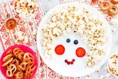 Sweet treats for children - popcorn pretzel bagel cookies. Face Stock Photo