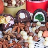 Sweet treats on a table. Sweet treats on a lace doily. Candies, hazelnut, walnut, cinnamon Royalty Free Stock Image