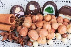 Sweet treats on a table. Sweet treats on a lace doily. Candies, hazelnut, walnut, cinnamon Stock Photo