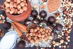 Sweet treats on a table. Sweet treats on a lace doily. Candies, hazelnut, walnut, cinnamon Stock Photography