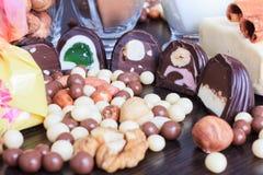 Sweet treats on a table. Sweet treats on a lace doily. Candies, hazelnut, walnut, cinnamon Royalty Free Stock Photos