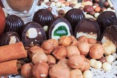 Sweet treats on a table. Sweet treats on a lace doily. Candies, hazelnut, walnut, cinnamon Stock Images