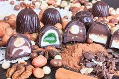 Sweet treats on a table. Sweet treats on a lace doily. Candies, hazelnut, walnut, cinnamon Royalty Free Stock Photography