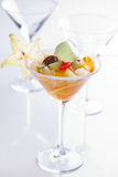 Sweet tropical fruit cocktail. In a glass Royalty Free Stock Images
